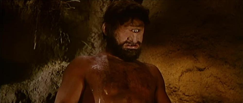 """Sos Orcos e sos Gigantes Nel tempo de sos de jàna (abitatori delle domus de jàna) c'erano anche sos Orcos che avevano un occhio solo in mezzo alla fronte e mangiavano carne umana. Erano molto potenti, abitavano nei nuraghi e avevano zanne di cinghiale, ed erano molto birbantes. I gigantes invece erano belli e potenti, mannos de istatura, e gli Orcos li temevano. Gli Orcos tormentavano invece i più deboli che erano gli uomini come noi. A questo proposito sos Mannos raccontavano: C'era un uomo bruttissimo e peloso, ma con due occhi come noi, che era chiamato Tinzòsu. Uno degli Orcos va nell'ovile di Tinzosu e gli dice: """"Ti voglio mangiare"""". """"Ite bisonzu b'hat de manicare a mie? – risponde Tinzosu – B'happo unu bellu porcu. Picca ca l'occhidimus e no nchelu manicamus"""". Tinzosu mette la carne negli spiedi, poi ne afferra uno arroventato e lo infigge nell'occhio dell'Orcu. L'Orcu accecato si lancia intorno all'ovile per uscire e non può. E così Tinzosu si salva. (Cercare ancora il racconto o farlo ripetere)"""
